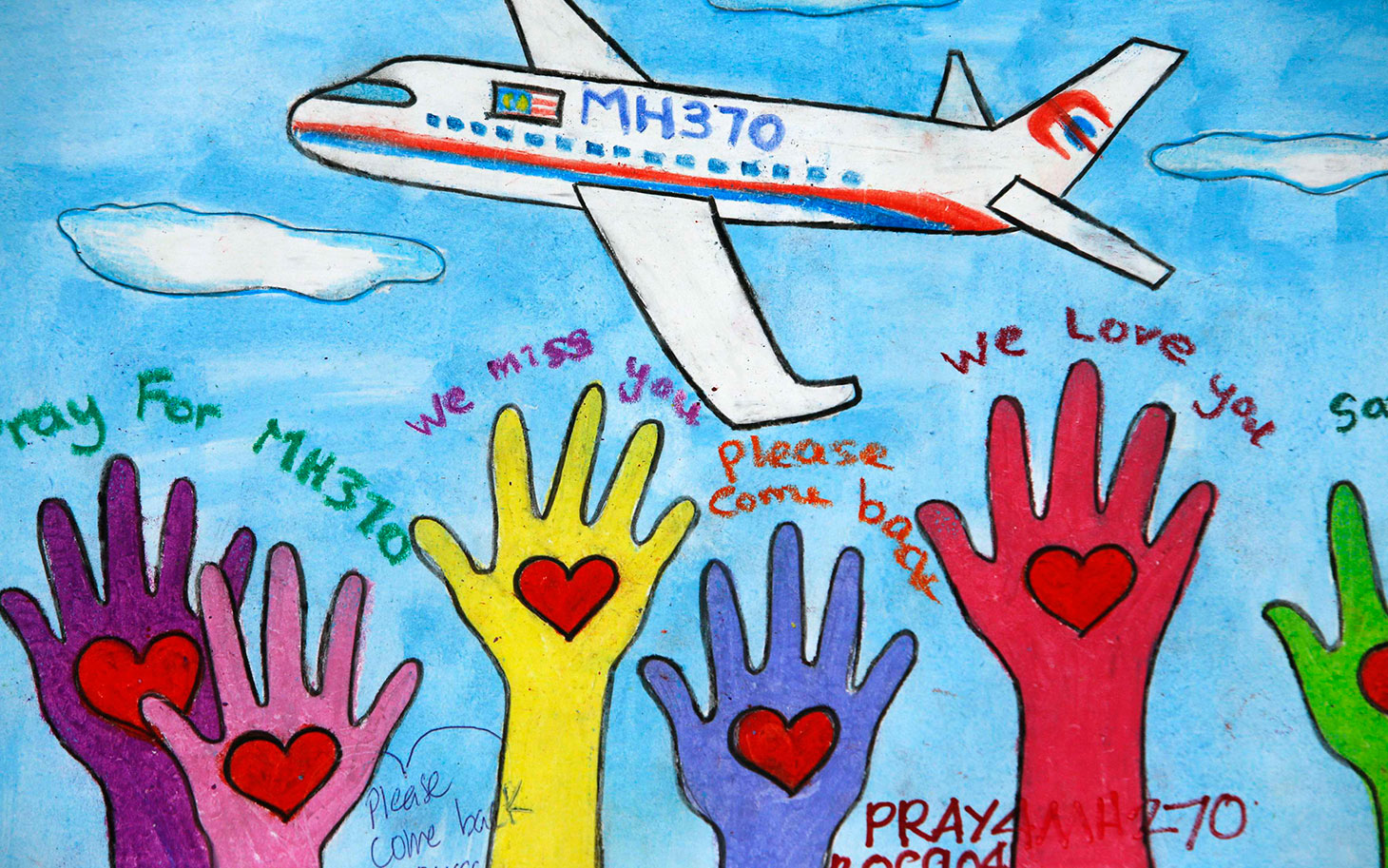 An artwork conveying well-wishes for the passengers and crew of the missing Malaysia Airlines Flight MH370 is seen at a viewing gallery in Kuala Lumpur International Airport March 19, 2014. REUTERS/Edgar Su (MALAYSIA - Tags: DISASTER TRANSPORT)